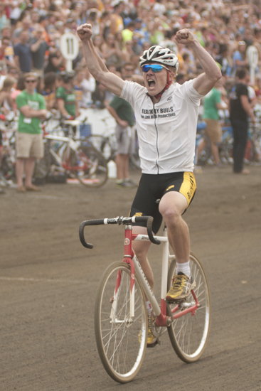 Jacob Miller celebrates as he crosses the finish line, bringing Black Key Bulls its first victory in the men\'s Little 500 at Bill Armstrong Stadium in Bloomington, Saturday, April 26, 2014.