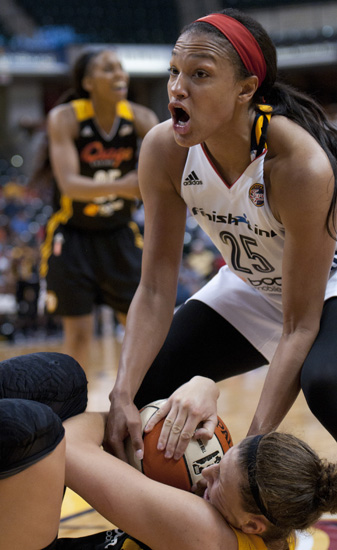 Fever forward Marissa Coleman yells for a jump-ball call as Shock forward Jordan Hooper tries to hold onto the ball during the Indiana Fever\'s 107-102 overtime loss to the Tulsa Shock at Bankers Life Fieldhouse, Wednesday, June 25, 2014.