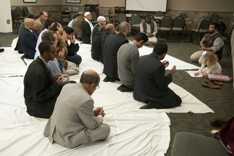 Adil Majid (far right), a member of the Muslim Student Association at Indiana University-Purdue University Indianapolis, leads a prayer of supplication for slain aid worker Abdul-Rahman (Peter) Kassig during a memorial service for Kassig at the Indiana Interchurch Center in Indianapolis, Saturday, Nov. 22, 2014.