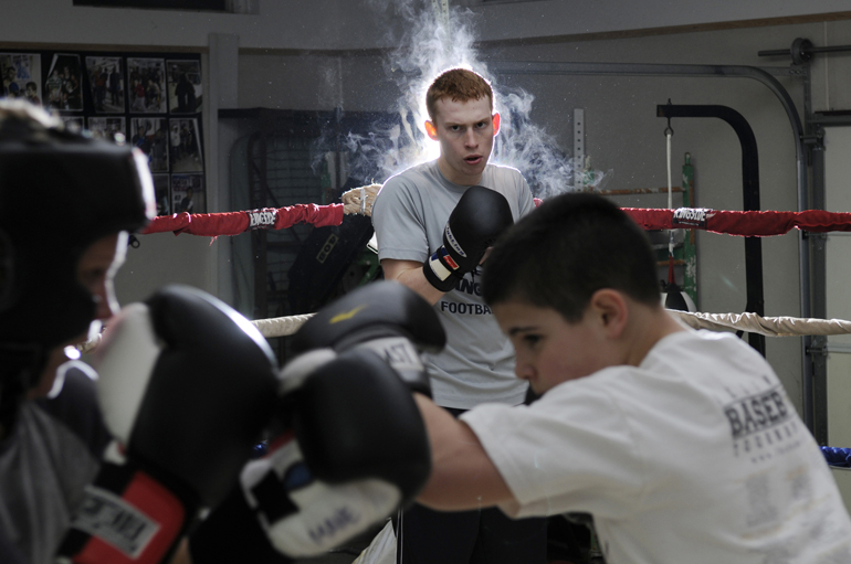 Lafayette Boxing Club\'s Tate Sturgeon watches as Kate Mane and Kyle Siple trade light jabs during a workout Tuesday, March 5, 2013, at the club building in Lafayette. Sturgeon and Mane, along with Luis Pena, Conan Hutchison and other boxers, will compete at the Indiana Golden Gloves tournament on March 23 in Indianapolis.
