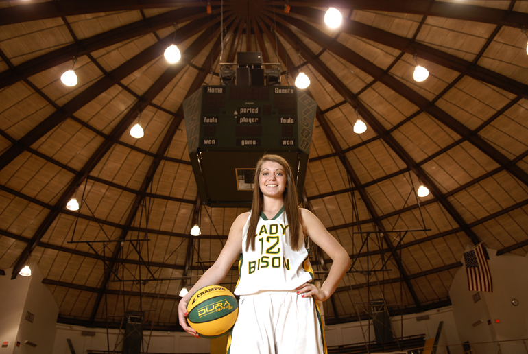 Benton Central High School senior Caitlyn Tolen, the Big Schools girls basketball player of the year, stands in the school\'s domed main gymnasium.