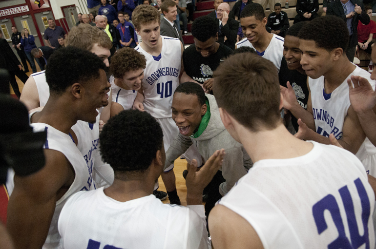 Brownsburg High School players huddle before the Richmond boys\' basketball team\'s 71-65 victory over Brownsburg for the Southport Regional title at Southport High School, Saturday, March 14, 2015.
