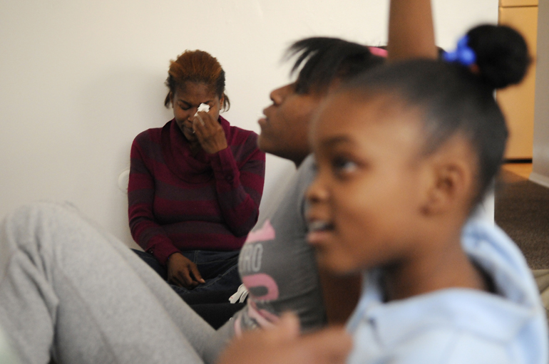 Levia Heffner cries as her daughter Jazmine, 10, answers a question from Peace Education Facilitator Naeemah Jackson of the Peace Learning Center at the Heffners