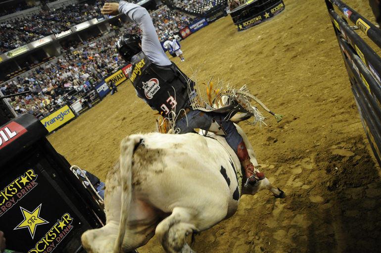 Chad Besplug holds onto Panhandle Slim clone Another One as the bull leaves the chute during the first section of championship day at Professional Bull Riders' Built Ford Tough Invitational on Apr. 15, 2012, at Bankers Life Fieldhouse in Indianapolis. Fabiano Vieira of Perola, Brazil, won the invite atop Who Dat in the championship round, earning $37,885.