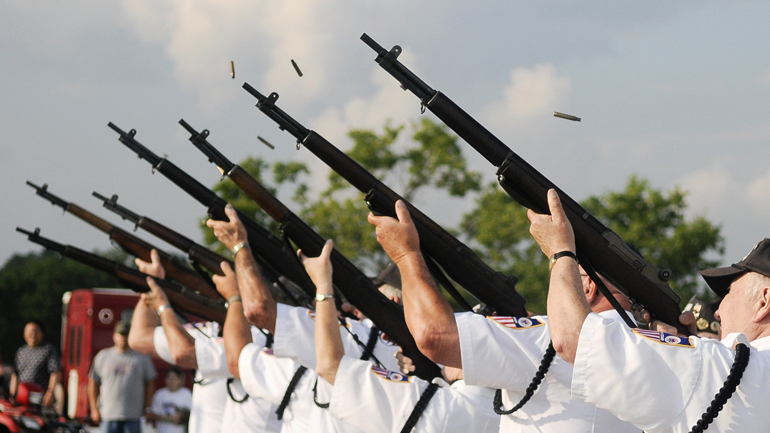 Members of the Monroe County Veterans Honor Guard fire a 21-gun salute during Fourth of July festivities on July 4, 2011, at the Monroe County Fairgrounds in Bloomington, Ind. Amvets Post 2000 organized the event, which included free music and fireworks.