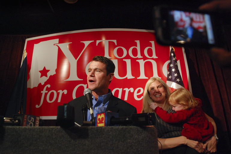 U.S. Representative-elect Todd Young (R-9th) talks to his supporters with his wife, Jenny, nearby during his victory speech Nov. 2, 2010, in Bloomington, Ind. Young beat incumbent Democrat Baron Hill 52 percent to 42 percent.