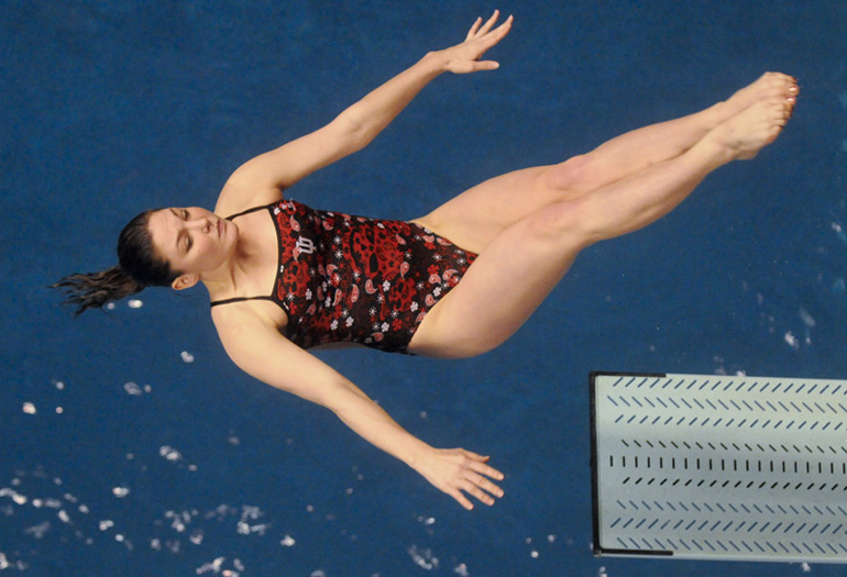 Indiana University senior Brittney Feldman performs her fifth dive in the three-meter springboard finals on the second day of the Big Ten Women