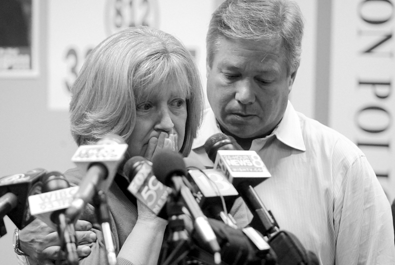 "Charlene Spierer cries as her husband, Robert, reassures her during the eighth press briefing on the search for their daughter Lauren Spierer on June 14 at Bloomington Police Department headquarters. National media reported the story four days after Lauren went missing, spurred by coverage from the Indiana Daily Student and @NewsOnLaurenS, a Twitter account that tweeted at celebrities to spread the word. (Full photo story <a href=""http://www.alex-farris.com/pages/spiererphotostory.html"" target=""_blank"">here</a>)"